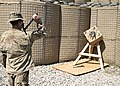 U.S. Army Spc. Kirk Calabrese with Bravo Company, 2nd Battalion, 23rd Infantry Regiment throws a tomahawk.jpg