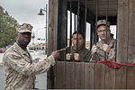 U.S. Marine Corps 1st Lt. Hubert Williams, an adjutant with Special Purpose Marine Air-Ground Task Force Africa 13, supervises fellow Marines during a jail and bail fundraiser to support the Navy-Marine Corps 130314-M-LZ697-175.jpg
