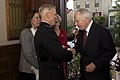 U.S. Marine Corps Gen. James F. Amos, second from left, the commandant of the Marine Corps, exchanges greetings with a guest during a reception in honor of retired U.S. Sen. John Warner, not shown, the Evening 130503-M-LU710-115.jpg