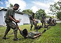 U.S. Marines assigned to a landing attack subsequent operations team conduct a combat conditioning exchange with Guatemalan marines as part of U.S. Marine Corps Martial Arts Program training during Southern 140819-N-XQ474-122.jpg