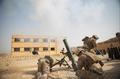 U.S. Marines fire mortars at ISIL.png