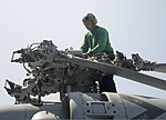 U.S. Navy Aviation Electrician's Mate 3rd Class Jonathan Turner, assigned to Helicopter Maritime Strike Squadron (HSM) 74, performs maintenance on an MH-60R Seahawk helicopter on the flight deck of the aircraft 130813-N-GR168-058.jpg