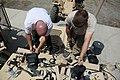 U.S. Navy Construction Mechanic 1st Class William Cook, assigned to Construction Battalion Maintenance Unit 202, attached to the Khost Provincial Reconstruction Team, and Brian Coll, a force protection Cougar 120811-A-PO167-056.jpg