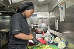U.S. Navy Culinary Specialist Seaman Donica Harris chops lettuce for a salad bar in a galley aboard the aircraft carrier USS Harry S. Truman (CVN 75) in the Atlantic Ocean July 24, 2013 130724-N-CE241-017.jpg