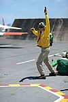 U.S. Navy Lt. Thomas Doran, a launch officer assigned to the aircraft carrier USS George H.W Bush (CVN 77), prepares to launch a T-45 Goshawk aircraft assigned to Training Squadron (VT) 9 during flight 130608-N-YZ751-054.jpg