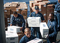 U.S. Sailors aboard the guided missile destroyer USS Stockdale (DDG 106) move boxes of supplies during a replenishment at sea in the Arabian Sea May 19, 2013 130519-N-HN991-169.jpg