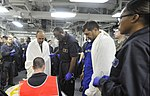 U.S. Sailors in the medical department of the amphibious assault ship USS Bataan (LHD 5) assess two Turkish mariners recovered by a Bataan search and rescue team in the Aegean Sea March 8, 2014 140308-N-AO823-053.jpg