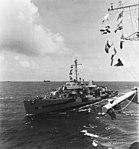 USS Paul Hamilton (DD-590) comes alongside USS Makin Island (CVE-93) on 11 March 1945 (NH 42812).jpg