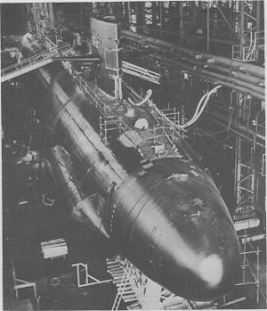 USS Sand Lance (SSN-660) - Sand Lance under construction at Portsmouth Naval Shipyard at Kittery, Maine, with temporary safety railings rigged around her deck. The external fairing on the lower hull was temporary, designed to provide added buoyancy for her bow and avoid excessive strain on her hull during her launching.