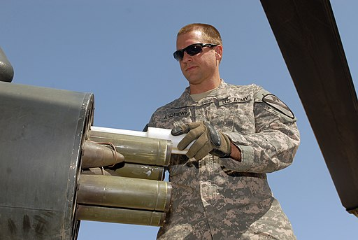 US Army 52455 CAMP TAJI, Iraq - Sgt. Scott Andrews, of West Point, Miss., loads rockets into the rocket pod of an AH-64D Apache helicopter, here, Oct. 1. Gibson is an armament electrical avionics repairer assigned