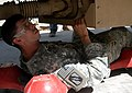 US Army 52574 Spc. Robert J. Algee, a mechanic from Senatobia, Miss., checks for leaks and other deficiencies during a quality assurance and quality check of an MRAP Sept. 30. Algee serves with B Company, 2nd Batt.jpg