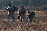 US Army Soldiers walk back to rally point after jump 141210-A-QW291-141.jpg
