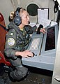 US Navy 030508-N-0020T-005 Lt. Kososki operates the tactical coordinator (TACCO) station.jpg