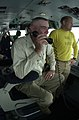 "US Navy 030527-N-2385R-003 R. Lee Ermey, host of the popular History Channel program ""Mail Call,"" uses the flight deck intercom system.jpg"