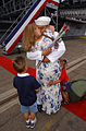 US Navy 030602-N-3236B-004 Aviation Structural Mechanic 1st Class David Sequira winner of the traditional First Kiss is greeted by his family as USS Constellation (CV 64) returns to its homeport of San Diego, Calif.jpg