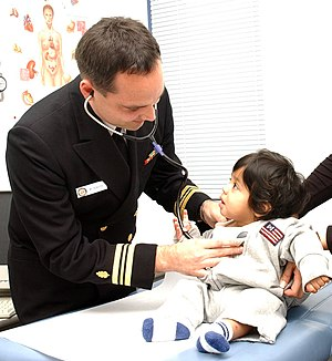 Nurse practitioner - Image: US Navy 031027 N 0000W 001 Family Nurse Practitioner Lt. Cmdr. Michael Service cares for a young girl at the U.S. Naval Hospital (USNH) Yokosuka