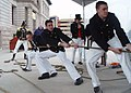 US Navy 040303-N-0335C-004 Seaman William Crandell, Seaman Christopher Cobb and Seaman Anthony Kizer heave hard on a 5,600-pound, 1812-era Naval long gun.jpg