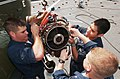 US Navy 040422-N-9849W-036 Sailors work together to repair a damaged engine on an SH-3 Sea King helicopter aboard USS Coronado (AGF 11).jpg