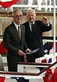 US Navy 040605-N-0247F-003 Former President Jimmy Carter (right) waves to the crowd as he and Navy Secretary, Gordon England take their seats for the christening.jpg