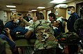 US Navy 050211-N-6665R-037 U.S. Navy Hospital Corpsmen and members of the non-governmental organization Project Hope, take-in a patient following a medical evacuation.jpg
