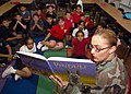 US Navy 050513-N-8055R-005 Personnelman 3rd Class Sabina Centeno reads to a fourth grade class at North Loop Elementary School in El Paso, Texas.jpg