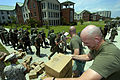 US Navy 050708-N-5328N-960 U.S. Marine Corps Staff Sgt. Chad Roach, foreground, and Gunnery Sgt. Ricdh Renner give pre-packaged meals to Marine students as they leave their barracks and line up to evacuate Naval Air Station (NA.jpg