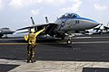 US Navy 051216-N-8163B-001 An F-14D Tomcat is directed into position for launch aboard the Nimitz-class aircraft carrier USS Theodore Roosevelt (CVN 71).jpg