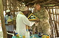 US Navy 060519-N-0411D-034 The Sultan of Tadjoura, Abdoulaker Moumat Houmed, hosts Rear Admiral Richard W. Hunt at his home for a ceremonial exchange of gifts and shared discussions.jpg