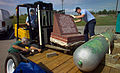 US Navy 061012-N-0857S-002 Mass Communication Specialist 2nd Class David Poe lowers the USS Golet memorial marker and Navy Counselor 1st Class Aaron Anspach guide it into place onto a flat bed trailer.jpg