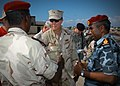 US Navy 061209-N-1328C-363 Commander, U.S. Naval Facilities Engineering Command Rear Adm. Richard E. Cellon speaks with Obock, Djibouti, city officials about a proposed pier project for Naval Mobile Construction Battalion Five.jpg
