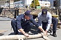 US Navy 070321-N-9520G-002 Fireman Jonathan Hudgens assists Boatswain's Mate 1st Class Adam Melancon as they prepare to make a boat fender used for tug boats moored at Fleet Activities Yokosuka.jpg