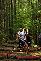 US Navy 070519-N-1688B-366 Runners navigate through the wooded portion of the third annual Rudy Run SEAL Challenge, held at Naval Amphibious Base Little Creek.jpg