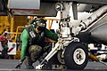 US Navy 070910-N-7883G-009 Airman Luis Estrada, topside petty officer for the waist catapult aboard USS Kitty Hawk (CV 63), verifies that the holdback bar is in place prior to launch.jpg