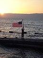 US Navy 071225-N-4571H-001 Sonar Technician Submarines 3rd Class Anthony Morandi observes evening colors on Christmas aboard the Los Angeles-class attack submarine USS Philadelphia (SSN 690).jpg