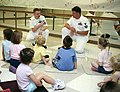 US Navy 080708-N-3271W-012 Electrician's Mate 1st Class John Campbell, left, and First Class Machinist Mate Clyde Barley, assigned to Pre-Commissioning Unit George H.W. Bush (CVN 77), speak to children at the Roanoke YMCA about.jpg