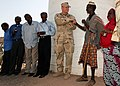 US Navy 080821-F-0919E-112 Lt. Greggory Markham, assigned to Combined Joint Task Force - Horn of Africa, meets with a delegation of villagers from Ali Faren, Djibouti.jpg