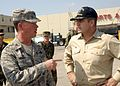 US Navy 080918-N-2804C-112 Col. John Nichols, Joint Task Force Commander, left, and Capt. Robert Lineberry, Commander of Amphibious Squadron 6 confer at a distribution point on Galveston Island, Texas.jpg