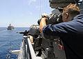 US Navy 080928-N-1082Z-031 Quarter Master 3rd Class David Kaelin observes the Military Sealift Command fleet replenishment oiler USNS John Lenthall (T-AO 189) through the.jpg