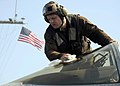 US Navy 081018-N-7571S-012 Storekeeper Seaman John Anderson wipes down the canopy window of an F-A-18C Hornet assigned to the.jpg