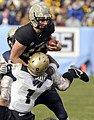 US Navy 081206-N-4565G-780 U.S. Military Academy quarterback Chip Bowden is sacked by U.S. Naval Academy Midshipmen during 109th Army-Navy college football game at Lincoln Financial Field in Philadelphia.jpg