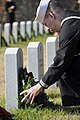 US Navy 081213-N-7987H-144 A Sailor lays a wreath on a fallen Veteran's tombstone during a Wreaths Across America Ceremony at the Alfred G. Horton, Jr. Memorial Veterans Cemetery.jpg