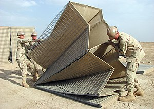 Hesco bastion - Image: US Navy 090411 N 8547M 025 Seabees assigned to Naval Mobile Construction Battalion (NMCB) 5 lift a HESCO barrier into alignment during a project at Camp Bastion