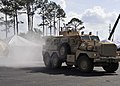 US Navy 090509-N-6889J-011 GULFPORT, Miss (May 9, 2009) A Mine Resistant Ambush Protected Vehicle drops a smoke bomb for concealment during a convoy security element display during Seabee Day 2009.jpg