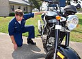 US Navy 090706-N-7427G-001 Electronics Technician 1st Class Dave Israel, a safety inspector assigned to Naval Air Station Joint Reserve Base New Orleans, inspects a loaner motorcycle.jpg