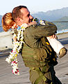 US Navy 091215-M-9234F-001 Lt. Brian Roberts embraces his son during his return to Marine Corps Air Station Kaneohe Bay, Hawaii.jpg