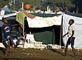 US Navy 100119-N-6266K-044 Two Haitians boys play soccer amongst make-shift homes outside Gheskio Field Hospital in Haiti.jpg