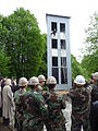 US Navy 100526-N-2167N-003 Ventspils firefighters demonstrate training techniques on a fire training tower as Seabees look on.jpg