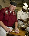 US Navy 100813-N-2389S-048 Culinary Specialist 1st Class Matthew Susienka prepares veal during the Le Cordon Bleu cooking competition as part of Chicago Navy Week.jpg