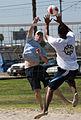 US Navy 100818-N-8479C-001 LT j.g. Jacob Davis, from Little Rock, Arkansas, assigned to the guided-missile cruiser USS Bunker Hill (CG 52) spikes a volleyball.jpg