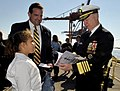 US Navy 101120-N-8273J-129 Chief of Naval Operations (CNO) Adm. Gary Roughead autographs the commissioning book for USS Gravely (DDG 107).jpg